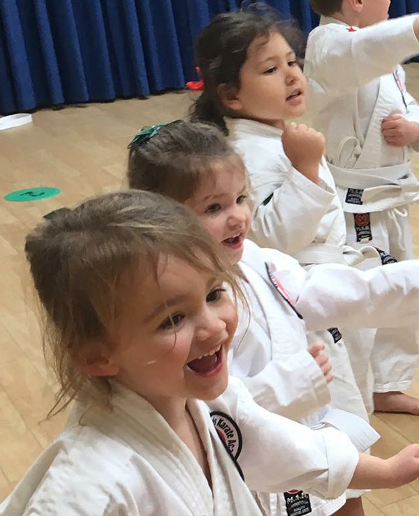 Children age 3 to 4 enjoying a karate lesson